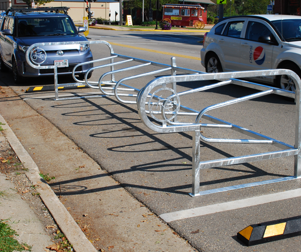 A bicycle corral in a single unit.