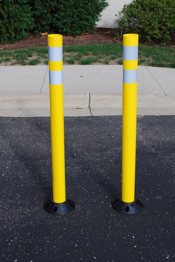 Yellow bike corral delineators.